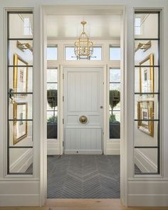 """Notice anything unusually fabulous about this foyer designed by Elizabeth Kimberly @Establish.Design? I'll accept """"everything"""" for an answer, but truly - those slate tiles installed in a herringbone pattern, where you might otherwise expect the hardwood flooring to carry through - is an awesome design detail! #getinspired"""