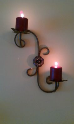 Wrought iron, wall mounted candle holder