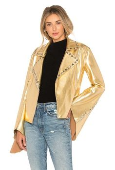 x Revolve Gang Jacket by Norma Kamali. 80% nylon 20% spandex. Hand wash cold. Silver tone star accents. Front zipper closure. Flared zipper sleeves. NKAM-WO49. ST4274SF002008. The first designer to receive a plaque on New York's 7th Avenue, she is credited with inventing the ... #normakamali #jackets #outerwear