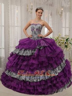 Affordable Purple Quinceanera Dress Sweetheart Zebra and Organza Beading Ball Gown  http://www.fashionos.com  http://www.facebook.com/quinceaneradress.fashionos.us  This quinceanera dress features a strapless bodice with a sweetheart neckline and luxury rhinestone. The animal-print bands adds wildness of the dress. And corset-style fit through the bodice. Below the waist, multiple tiers create volume and dimension.