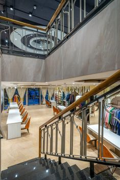 A Fashion Boutique Store Speaking Dynamism With Tinge Of Traditional Element | Nikhil Jain Architects - The Architects Diary Bespoke Clothing, Staircase Ideas, Railing Design, Floral Theme, Boutique Stores, Create Space, Stone Flooring, Design Firms, Second Floor