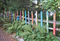 Want to try this with the neighborhood kids this summer. Painted Pickets add visual interest in the garden.