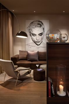 ME by Meliá opens its first hotel in Italy: Standing lamps are by industrial designer Achille Castiglioni and artworks are by Madrid-based fashion and music photographer Alberto Von Stokkum.