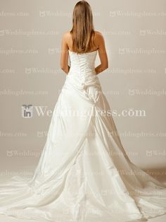 Modest Taffeta A-Line Bridal Dress. Strapless Taffeta wedding dress. The bodice has a sweetheart neckline and features asymmetrical pleating and flows into a draped skirt. The beading is enhanced at the side waist. The back is a corset closure. This dress is fully lined.