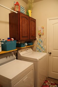 Tension bar in laundry room to hang clothes. Good idea!