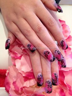 Coloured acrylic, black netting and freehand black rose nail art