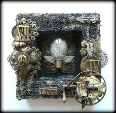 Prima Blog: Mixed-Media 3 Ways: Take 3 (View1) - This Amazing creation was created by Keren Tamir. She used graphite paste & Prima micro beads & then lots of Finnabair and Prima metals and elements Prima Projects.