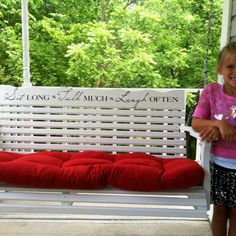 Front porch swing...love spending time here by my fish pond...