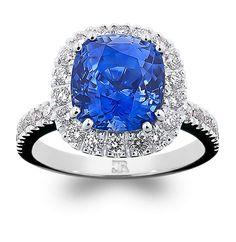 Something... blue. A gorgeous corflower blue cushion cut sapphire, of superior luminosity, in a fully hand-made 18 carat white gold setting featuring claw set