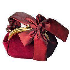 This Franchi Velvet Handbag looks like it's been gift wrapped to perfection with its large bow in front. I honestly don't see myself purchasing this bag even though it has this incredibly attractive red color. The design is too matronly for me and it just doesn't have that sleek style which will last for a lifetime. The Franchi Velvet Handbag looks nice, but it's not timeless and interesting enough.This sells for $135.