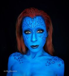 Mutant and proud. I love me some X-Men! And who wouldn't want to be a kickass shapeshifter like Mystique?!? Who's your favorite mutant? I made the scales out of hot glue and I applied them with liquid latex. It was soooo flippin tedious but the texture looked pretty cool! Also used lots and lots of blue @mehronmakeup paradise paint and red for my hair.