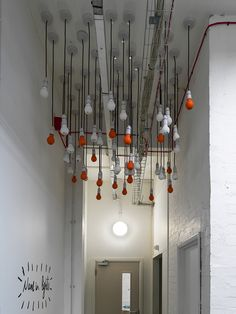 We love this light-fitting/art installation in Cardbpard Citizens' London HQ - each bulb is decorated with the name of one of the charity's patrons. #officedesign #creative #quirky