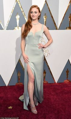 Thighly impressive: Her dress was equipped with a daring split that showcased her toned right leg