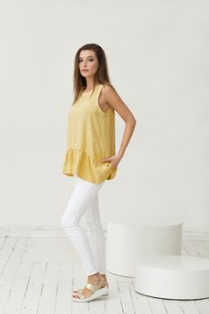 This feminine pure linen top with ruffles in pale yellow colour will make an effortless addition to your wardrobe. Linen is not only natural, breathable, dries fast, but is also extremely durable, letting you enjoy the linen clothes for a long years. Features: - sleeveless - asymmetrical