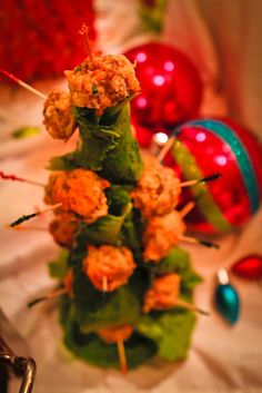 more tacky food for your Whobilation Christmas party - sausage balls attached to a lettuce covered styrofoam cone.