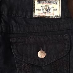 NWT True Religion Becky dark wash jeans 27W 34L Brand new with tag still attached (tag is cut off a bit because these were a gift) but absolutely mint and never worn.  The pictures show more of a black, but these are actually a very dark wash navy denim. They are a bit dressy and perfect for holiday parties.  Don't miss your chance to score brand new True Religions in the popular Becky cut at a fraction of the original cost.  True Religion Jeans