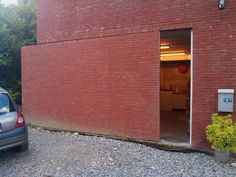 Sliding brick door