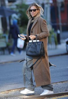 Natural beauty:Sienna Miller looked to be enjoying a break from her jam-packed schedule a...