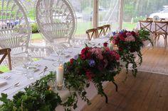 #bridaltable #flowerhedge #moodytoning #richcolours #candlesandholders #peacockchairs #receptioninspiration #vineyardwedding #countrystyle   Arbour flowers reused on the bridal table