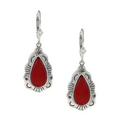 Set in sterling silver, these leverback earrings feature red coral teardrop cabochons with a southwest design on the trim. Highlighting the color of the stones, these earrings offer an antiqued finish.