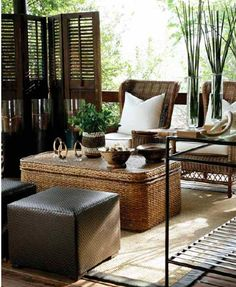 Yvonne O'Brien: This elegant, neutral tone outdoor sitting room is finished out with woven furniture & tribal inspired accessories.