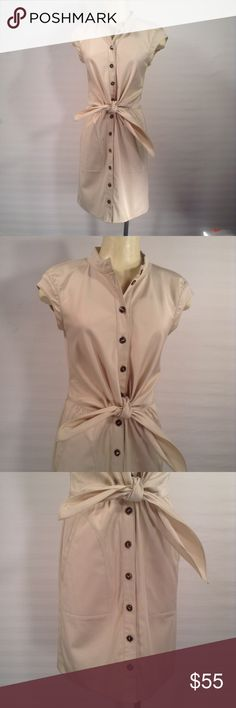 Escada Khaki Tan Bow Dress Size 34 A khaki tan dress by Escada ,size 34. The button up dress has tie detail at waist and measures 36 inches collar to hem. The dress is in very good, gently worn condition, no noticeable flaws. Please feel free to email me with any questions or concerns. Thanks for you'r interest. Escada Dresses Midi
