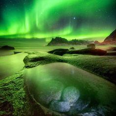 Northern Lights illuminating Lofoten, Norway. Photography by @DanielKordan.