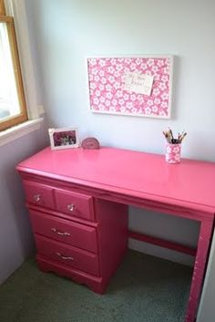 Reminds me of the little desk I had when I was younger...but plain wood.  Pink is even cuter : )