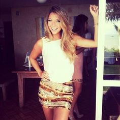 Golden sparkly skirt and white tank top