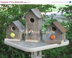 This set of three rustic birdhouses is crafted from old reclaimed weathered barnwood from Mississippi buildings & structures. They are built