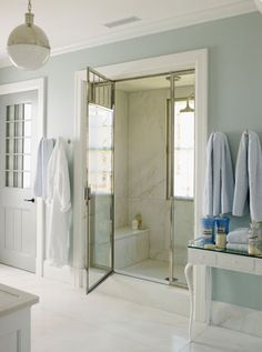 marble sheet walls inside shower - reduces grungy grout problem.