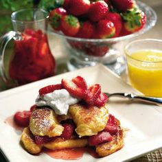 Croissant French Toast With Fresh Strawberry Syrup | Bring inspired French flavor to your brunch table this weekend. Stale croissants work best in this recipe, so pick them up mid-week and try to resist the temptation to gobble them up before it's time. | SouthernLiving.com