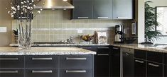 Modern kitchen design that features Brushed Nickel pulls from the Skyline collection.