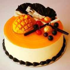 Mango Delight Cake with touch little Chocolate Truffle border plus Chocolate garnish by Chef Anwar !