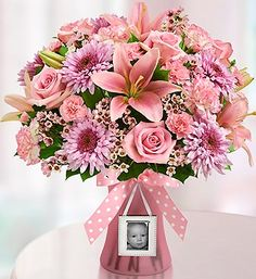 Sweet Baby Girl™ Arrangement- roses, lilies, delphinium, alstroemeria, poms, solidago and salal. Includes a keepsake magnetic mini photo frame and stylish ribbon. $49.99- $69.99 #newbaby #baby