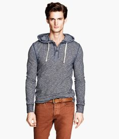 Hooded top in soft jersey with short button placket, drawstring hood and ribbed cuffs. H&M