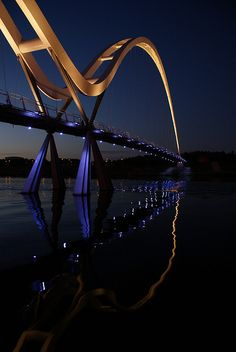 The Infinity Bridge is a public pedestrian and cycle footbridge across the River Tees in the borough of Stockton-on-Tees in the north-east of England. Ing Civil, Places Around The World, Around The Worlds, River Tees, Ouvrages D'art, Stockton On Tees, Bridge Design, Pedestrian Bridge, Foto Art