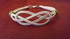 adjustable sailor knot bracelet, made from recycled guitar strings.