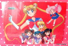 A shitajiki / illustration picture board for the Japanese shojo anime, Sailor Moon. The stationery item with the illustration of Usagi, Makoto, Ami, Minako, Rei and Chibiusa is for Sailor Moon R.