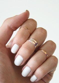 White nail polish + gold rings