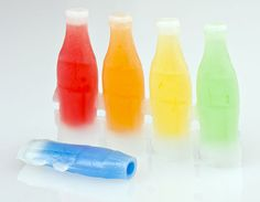 Nik-L-Nip juice confections in wax bottles were created early in the 20th century.  The brand name is derived from a combination of the original cost (nickel) and the preferred wax bottle-opening technique.