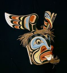 Pugwis With Heron mask - Trevor Hunt  (Pugwis is a Kwakwaka'wakw undersea spirit in human form. Pugwis is depicted with a fish like face, round eyes in well defined round sockets, gills, prominent, rounded contours on the face; and two large, beaver-like front teeth.)
