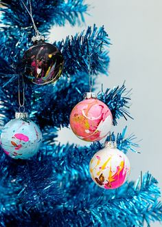 Add extra personality to your Christmas tree with a set of DIY splatter bauble ornaments.