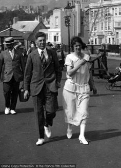 Sidmouth, A Couple 1924. From The Francis Frith Collection, a privately-owned archive of over 130,000 photographs of Britain from 1860-1970 that you can browse online for free anytime. #francisfrith #photography #nostalgia