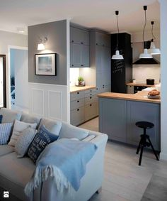 Riviera of blue - Living room with kitchen, Scandinavian style - image of SHOKO.design