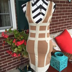 Alluring bandage Body con dress Sexy and  beautiful body con dress. Very stretchy. Can fit to medium. Low and sexy neckline. WOW couture Dresses Mini