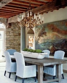 Dreamy dining room - beams, stone wall, rustic wood table, ethereal canvas, light blue traditional chairs