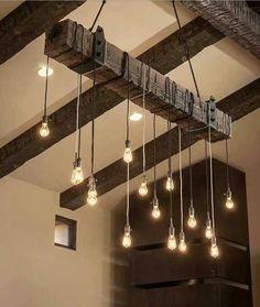 Luminaria con casquillos en una viga