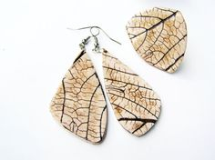 Hey, I found this really awesome Etsy listing at https://www.etsy.com/listing/211957306/white-and-brown-leaf-impression-jewelry