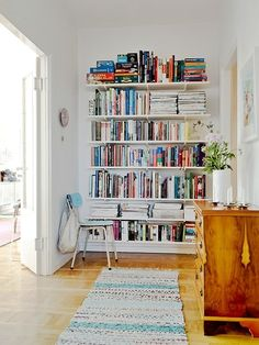 open shelves full of books (via Pinterest)